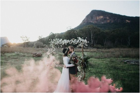 Pastel Pink Smoke with Wedding Arch