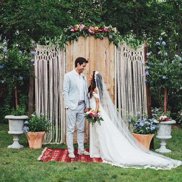 Boho Wedding Couple with Macrame Backdrop