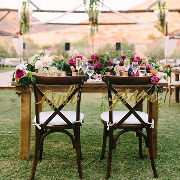 Sweetheart Table with Flowers and Bride and Groom