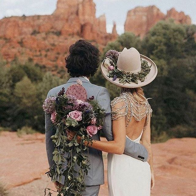 What's more badass...this bride's amazing floral hat and dress...or having a cactus bouquet in the desert?! You decide! #couplegoals Inspiration via @jordanvoth and @misshayleypaige dress 🌵 . . . #bohowedding #bohemianwedding #brideandgroom #weddingbouquet #instawedding #weddinggown #weddingdress