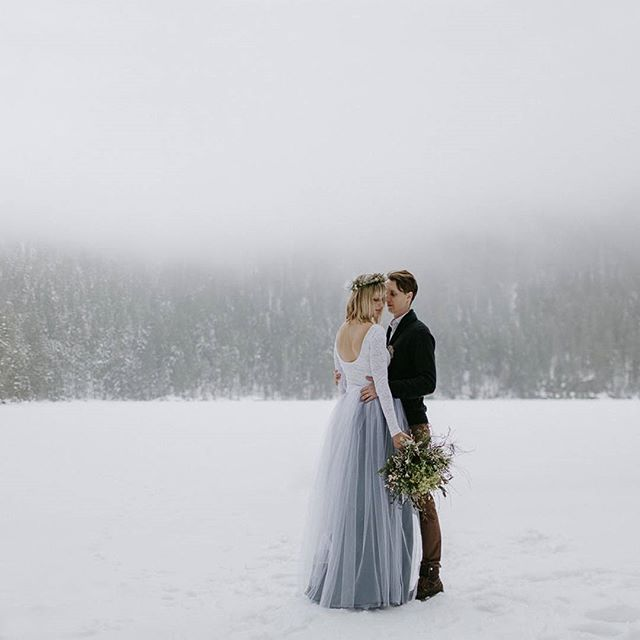 Bride and Groom in Winter with Flowers