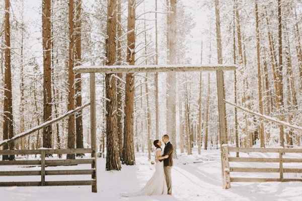 Winter Wedding Couple in Forest with Arch