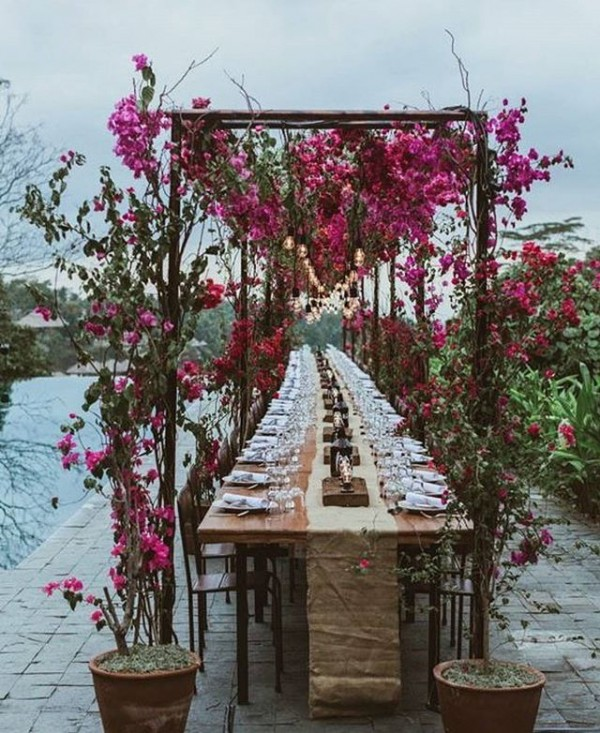 Outdoor Dining Tablescape with Floral Arches