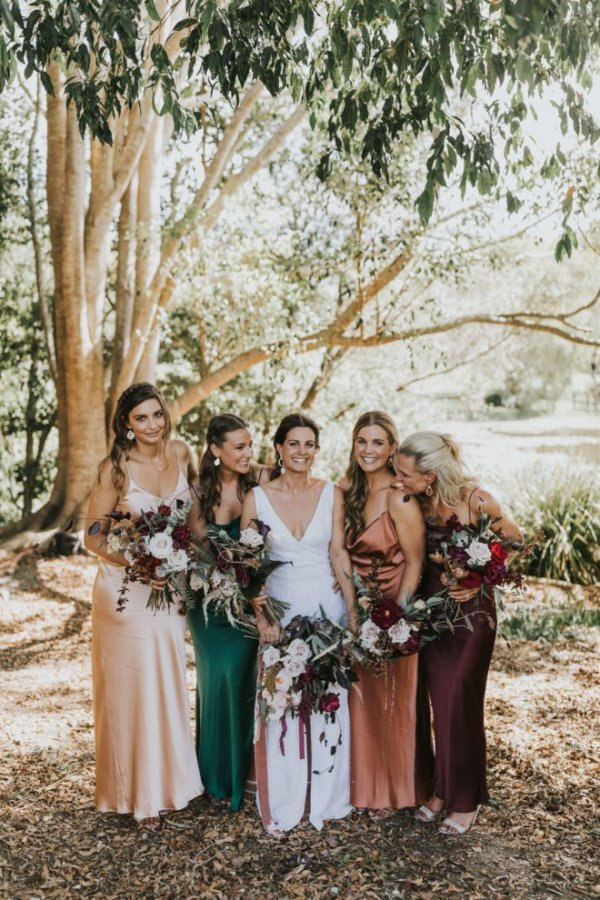 Bride and Bridesmaids in Jewel Tone Dresses