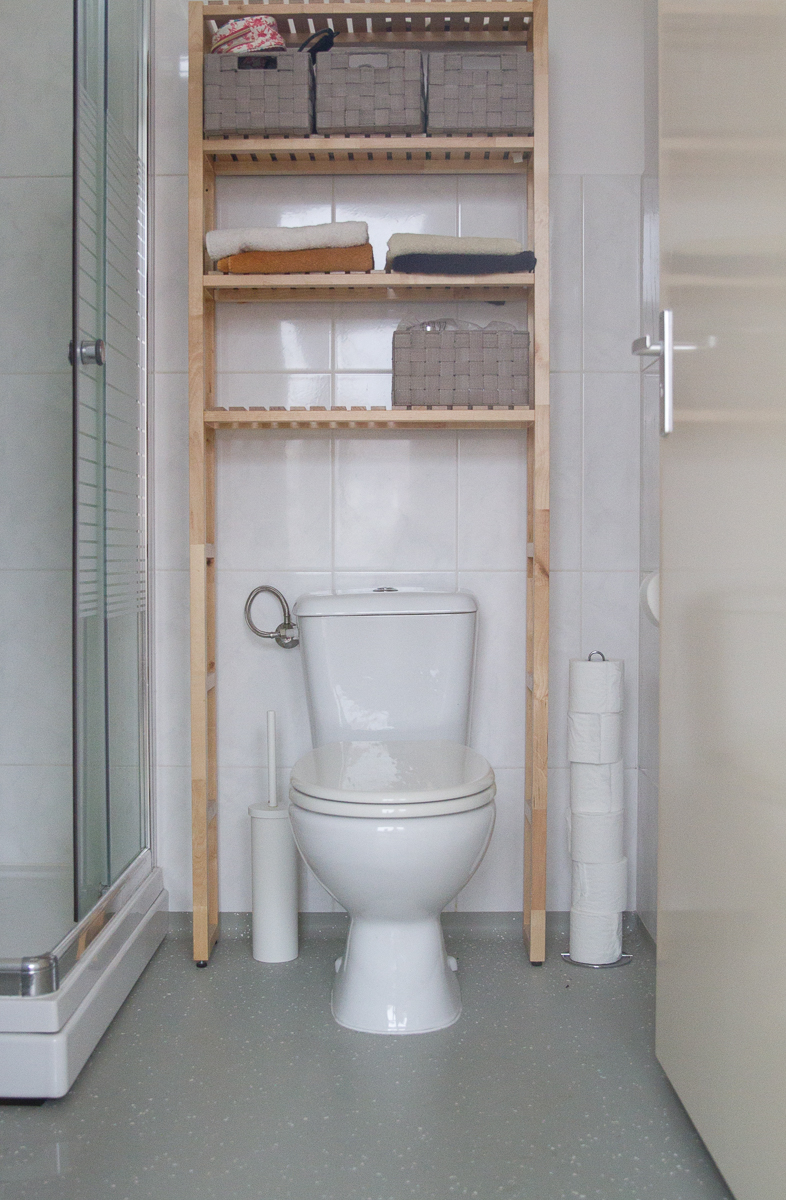 Our bathroom with additional storage. Forget cabinets here - we're lucky to even have a medicine cabinet!