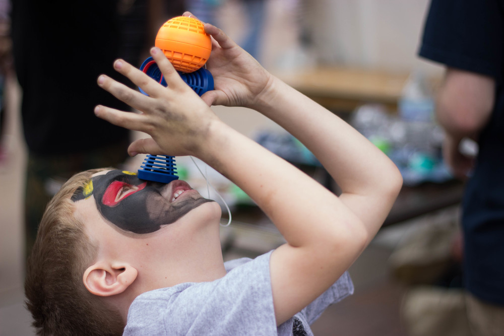 Carson Emory, 6, of Phoenix, Ariz. plays with a prize he won at the Matsuri Festival at the Heritage & Science Park in Phoenix, Ariz. Sunday afternoon. (Photo by Gretchen Burnton)