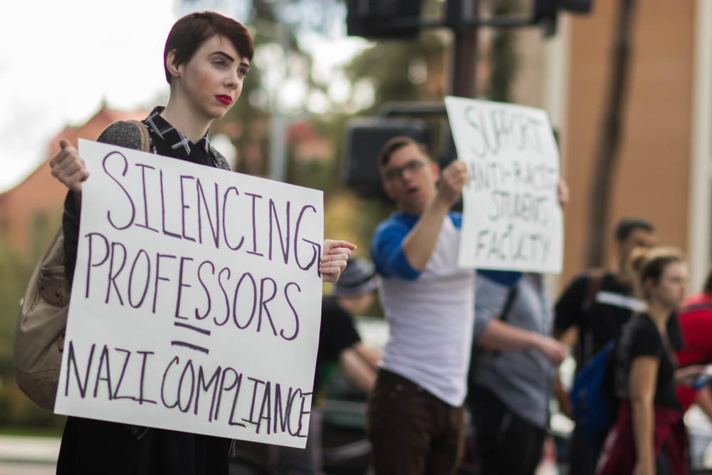 Senior ASU student Laine Baker of Gilbert, Ariz. and Junior ASU student Jordan Burke of Tempe, Ariz. stand in protest against National Youth Front and ASU's lack of action against the white nationalist group Tuesday afternoon. (Photo by Gretchen Burnton)
