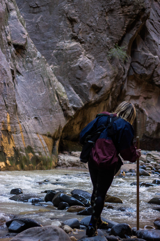 Jessica Obert, 22, of Phoenix, Ariz. hikes the Narrows trail in Zion National Park in Hurricane, Utah. (Photo by Gretchen Burnton)