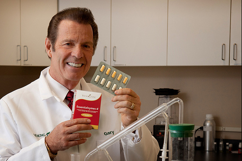 Gary Young, our founder, with ESSENTIALZYMES-4. Our enzymes are enteric-coated and will digest in the colon which will work for you!