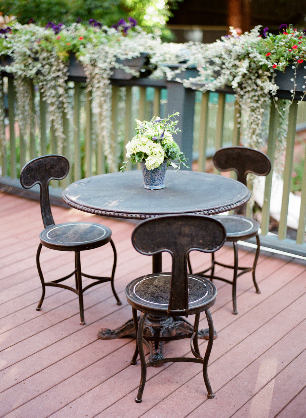 Iron Patio Table with Flower Arrangement