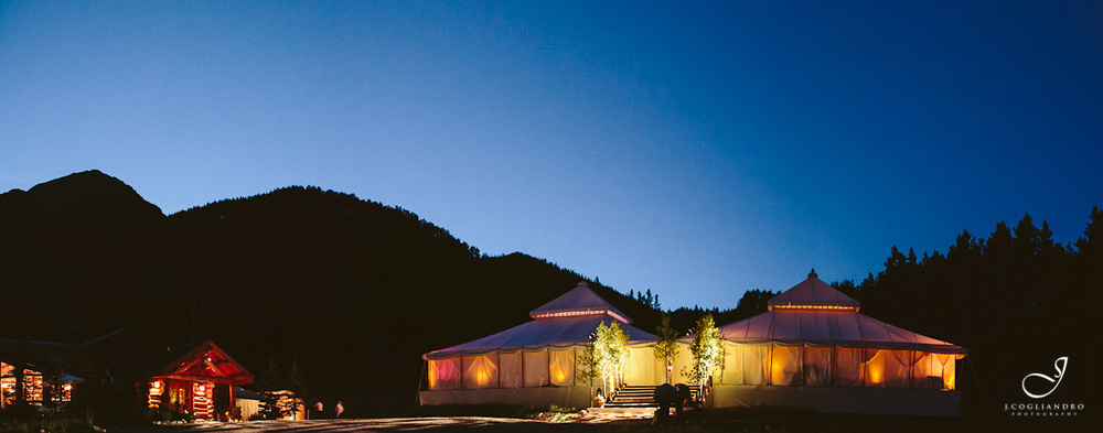 Reception Tents Lit at Night Against Mountains