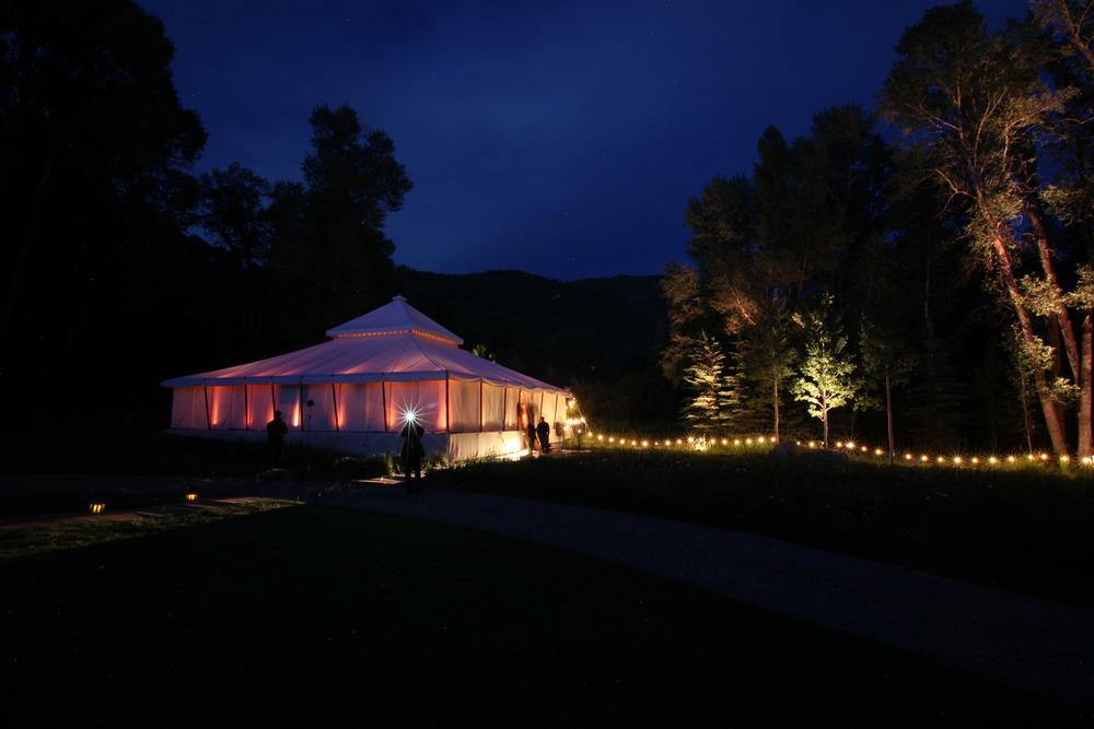 White Wedding Tent At Night with Lantern Walkway