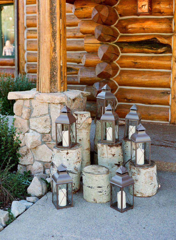 Copper lanterns stacked on Aspen tree logs