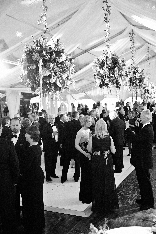 Guests dancing inside wedding reception tent