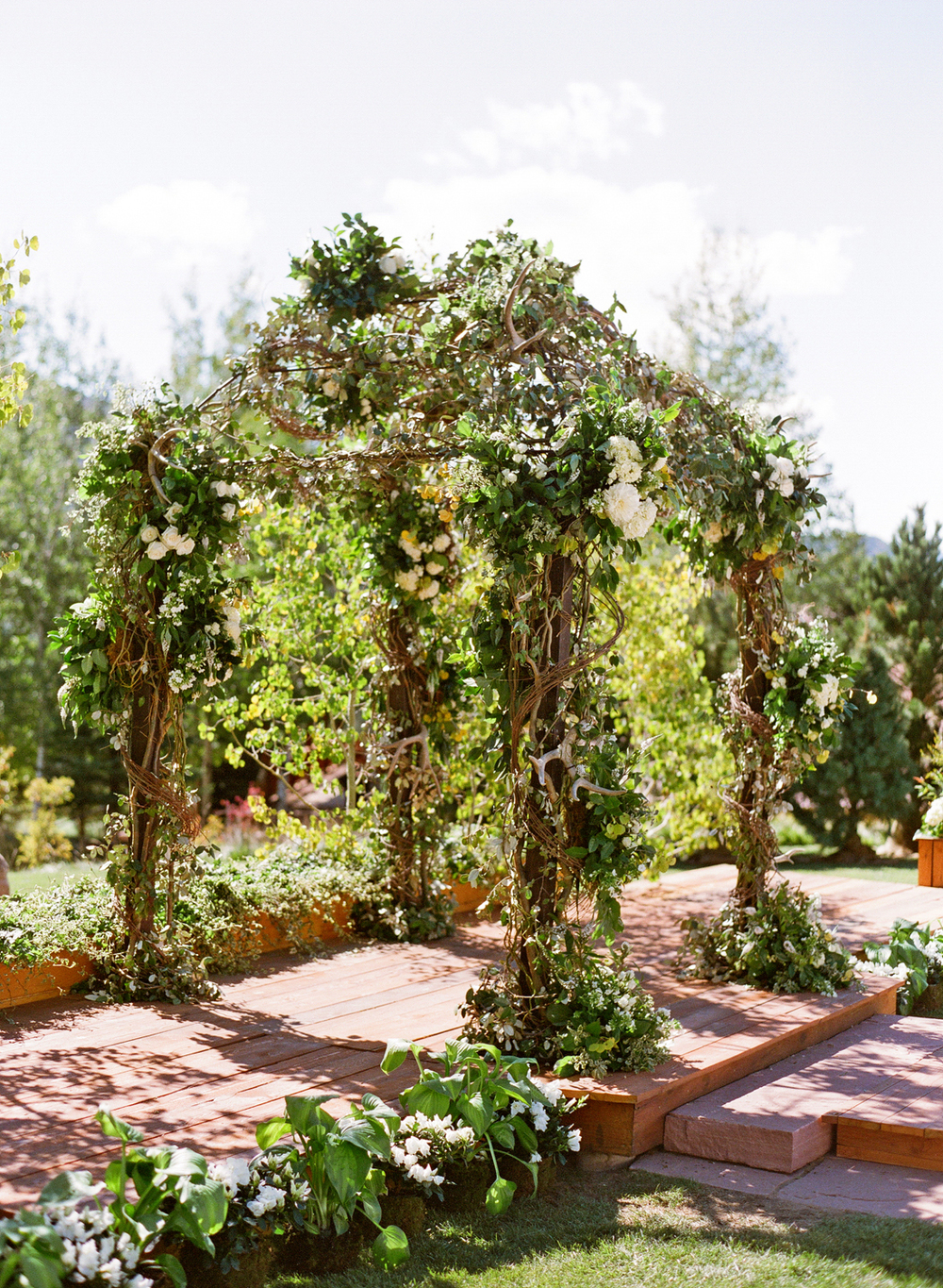 Outdoor wedding arbor made of greenery