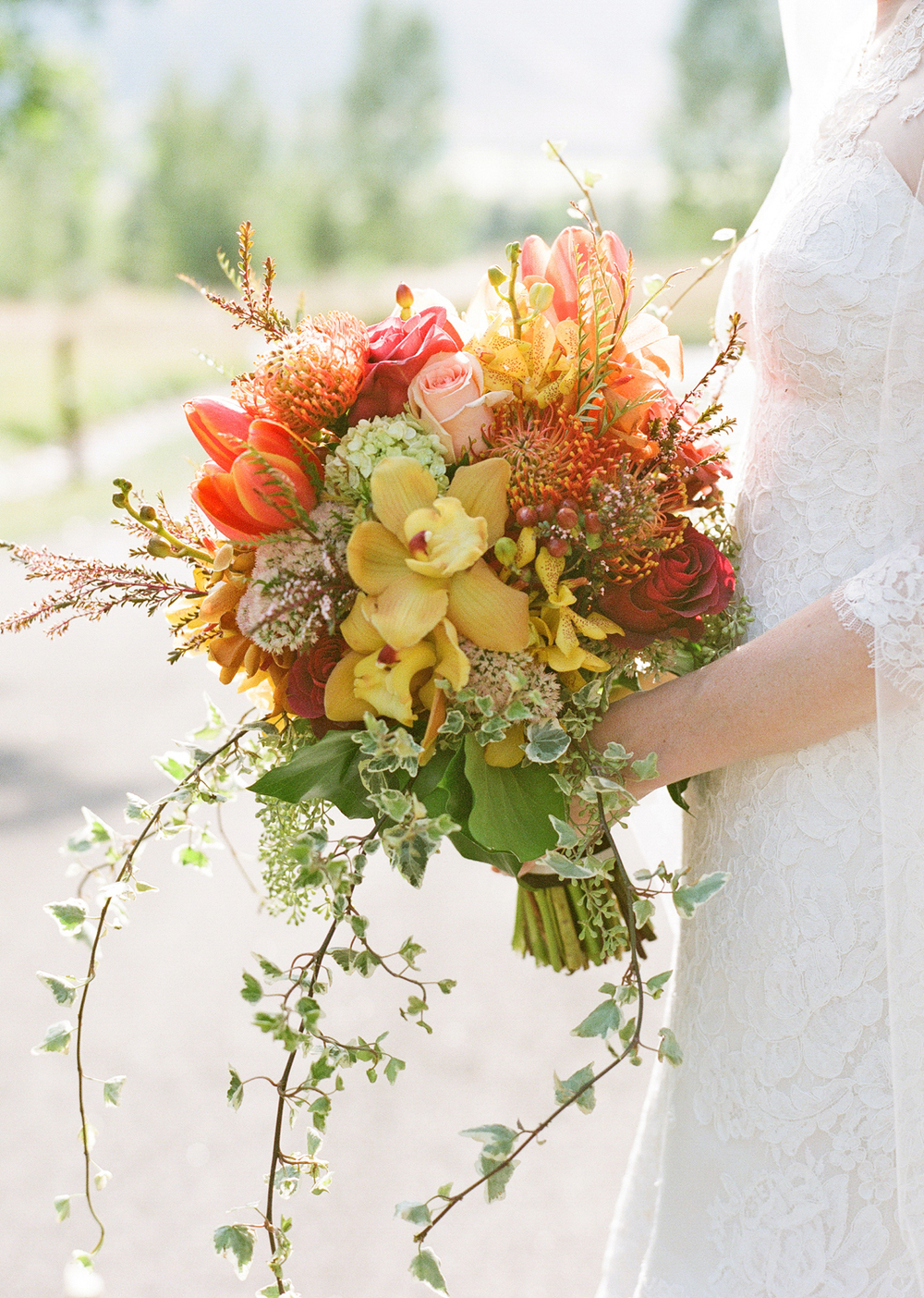 Fall bridal bouquet with red, yellow, orange and green flowers