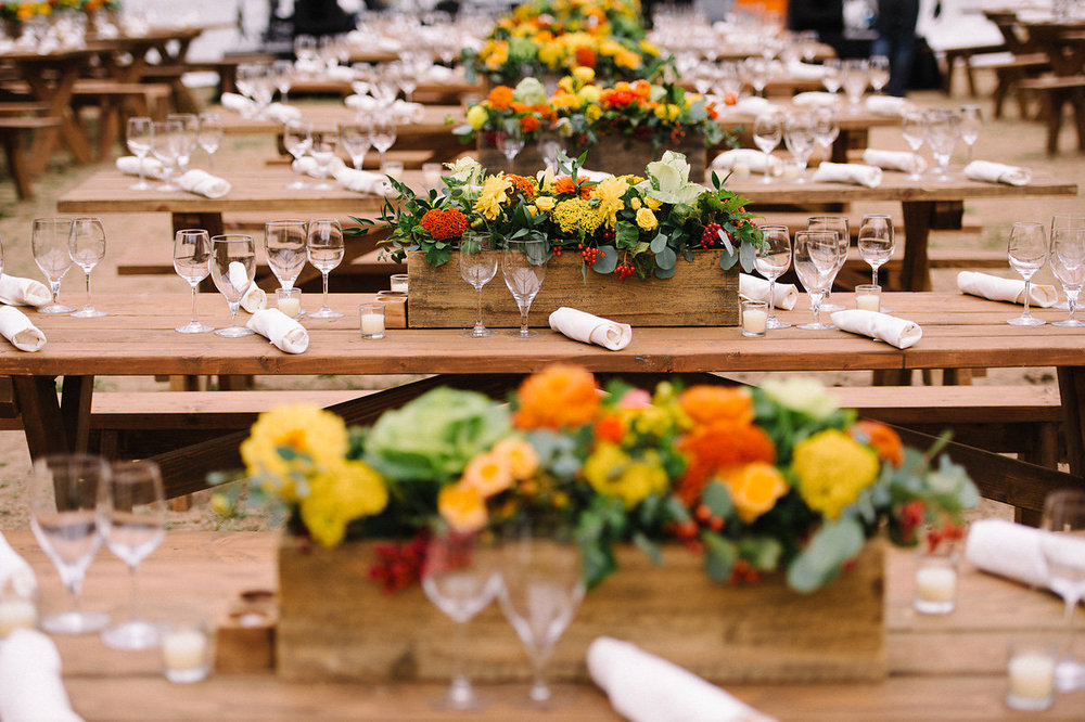 Rustic Picnic Tables with Flower Centerpieces