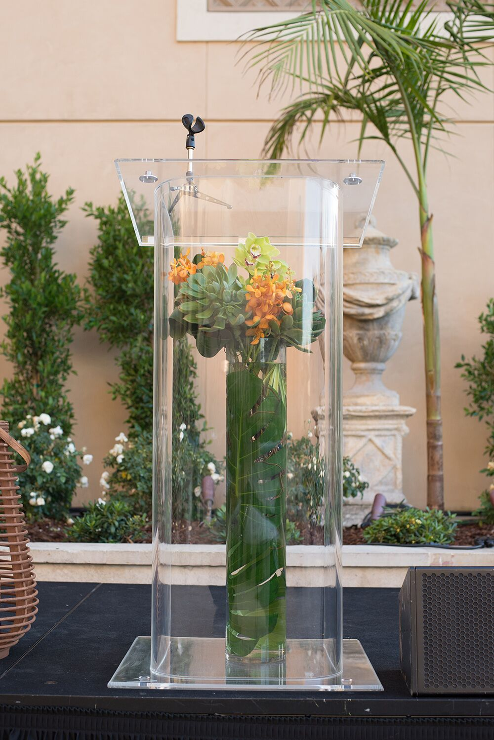 Flower arrangement inside lucite podium