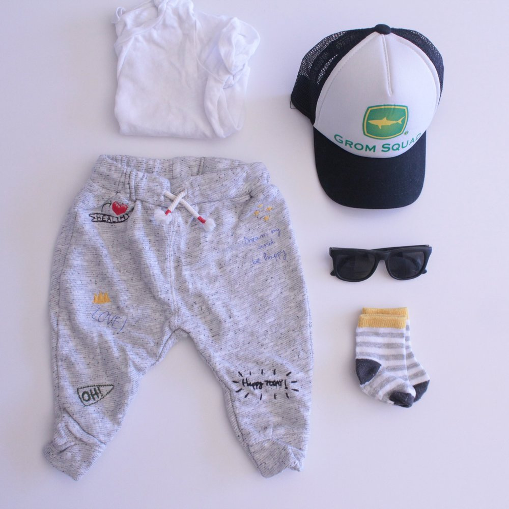 Clothes- Zara has hands down the best baby clothes Grom Squad- seriously, the cutest beach baby hats for little to cover up from the sun. Sunnies- for those delicate baby eyes. Socks are from Carters. They actually stay on a don't slip off!
