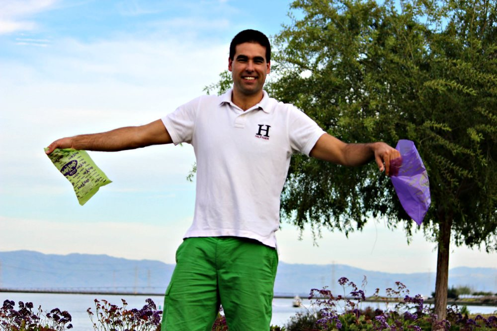 Helpbags founder holding the bags.jpg