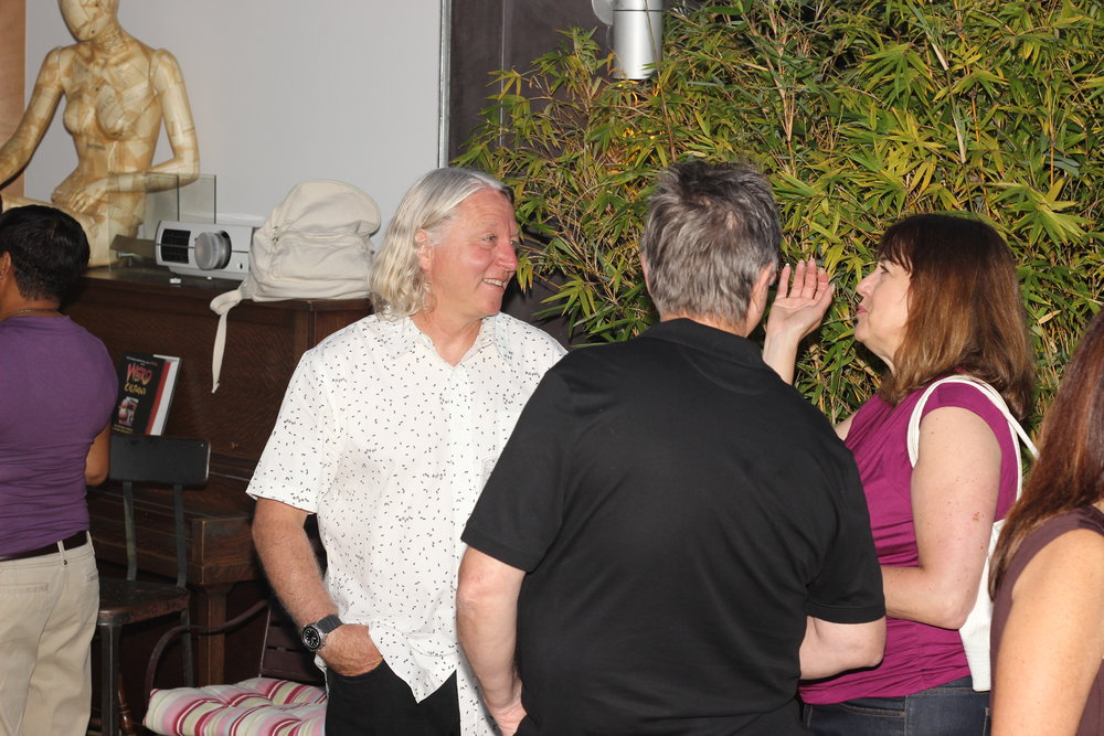 Terry talking to members of The Cult.