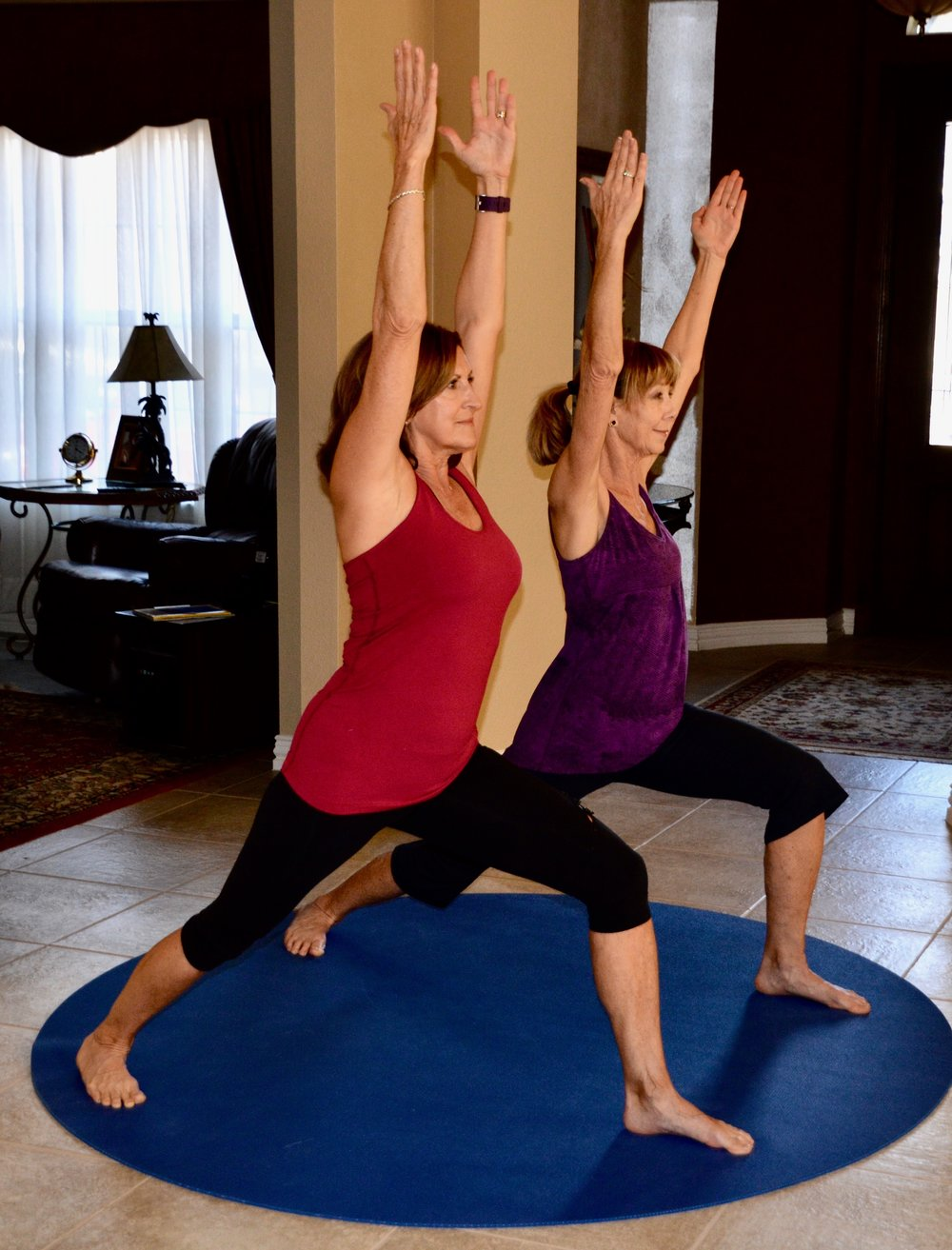 "Robson Ranch Yogi's Connie Cline & Janelle Roth ""reving"" up their metabolism with a Warrior I."