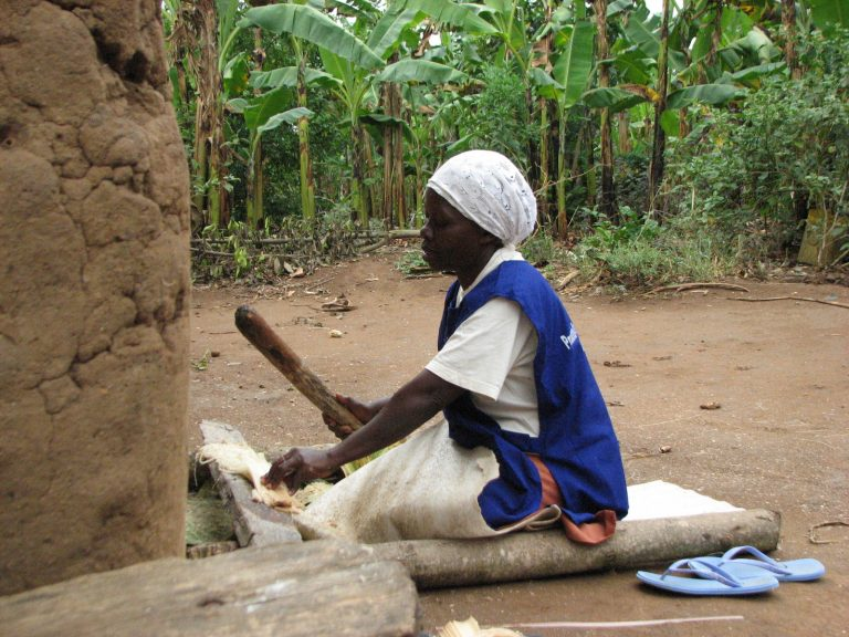Maria Nantubwe prepares banana fiber