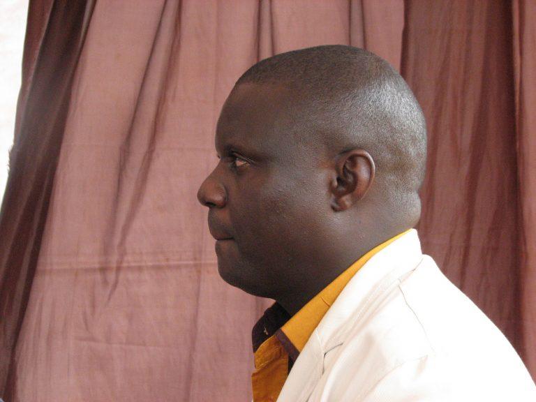 Joseph Nkandu listens to Jeff Miller