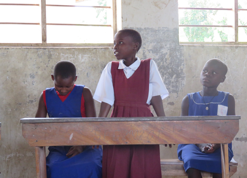 Three school girls at Bukibura Primary School during menstruation education and business skills training.