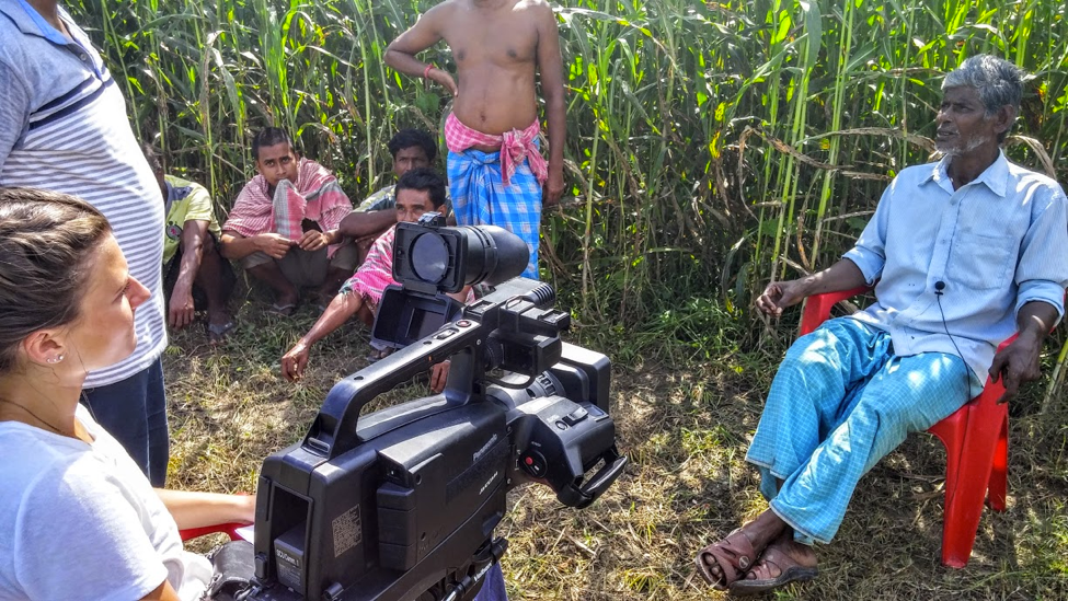 Global Social Benefit Fellow Erika Francks interviewing rural farmers in India.