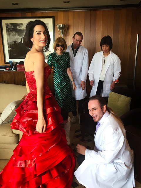 Amal Clooney getting couture treatment by John Galliano for Maison Margiela pre-Gala. Anna Wintour looks on.