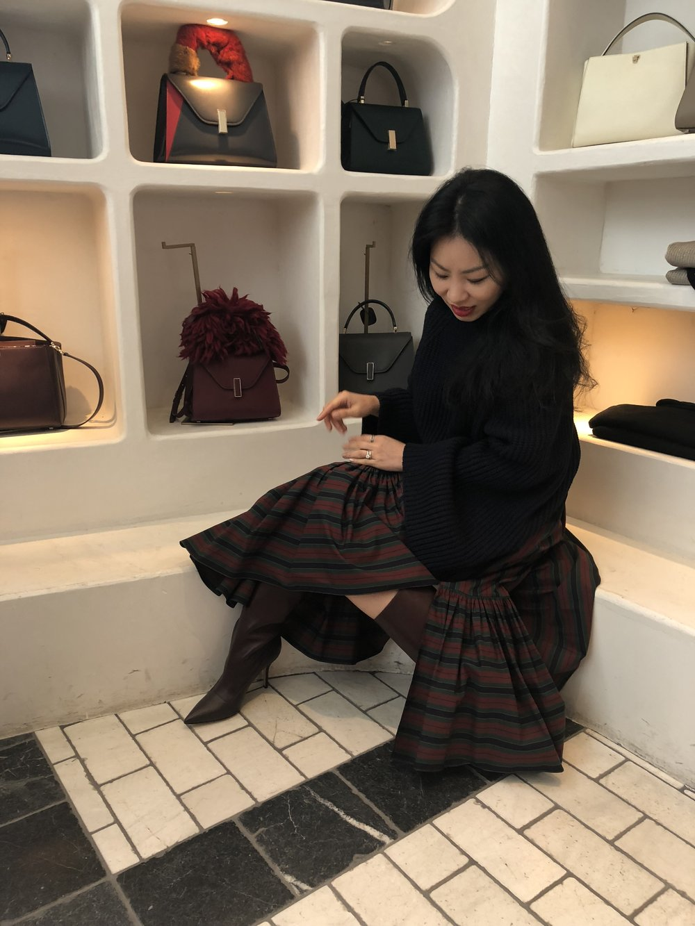 Yura's daytime look featuring Rosetta Getty knit and skirt plus Paul Andrew boots.