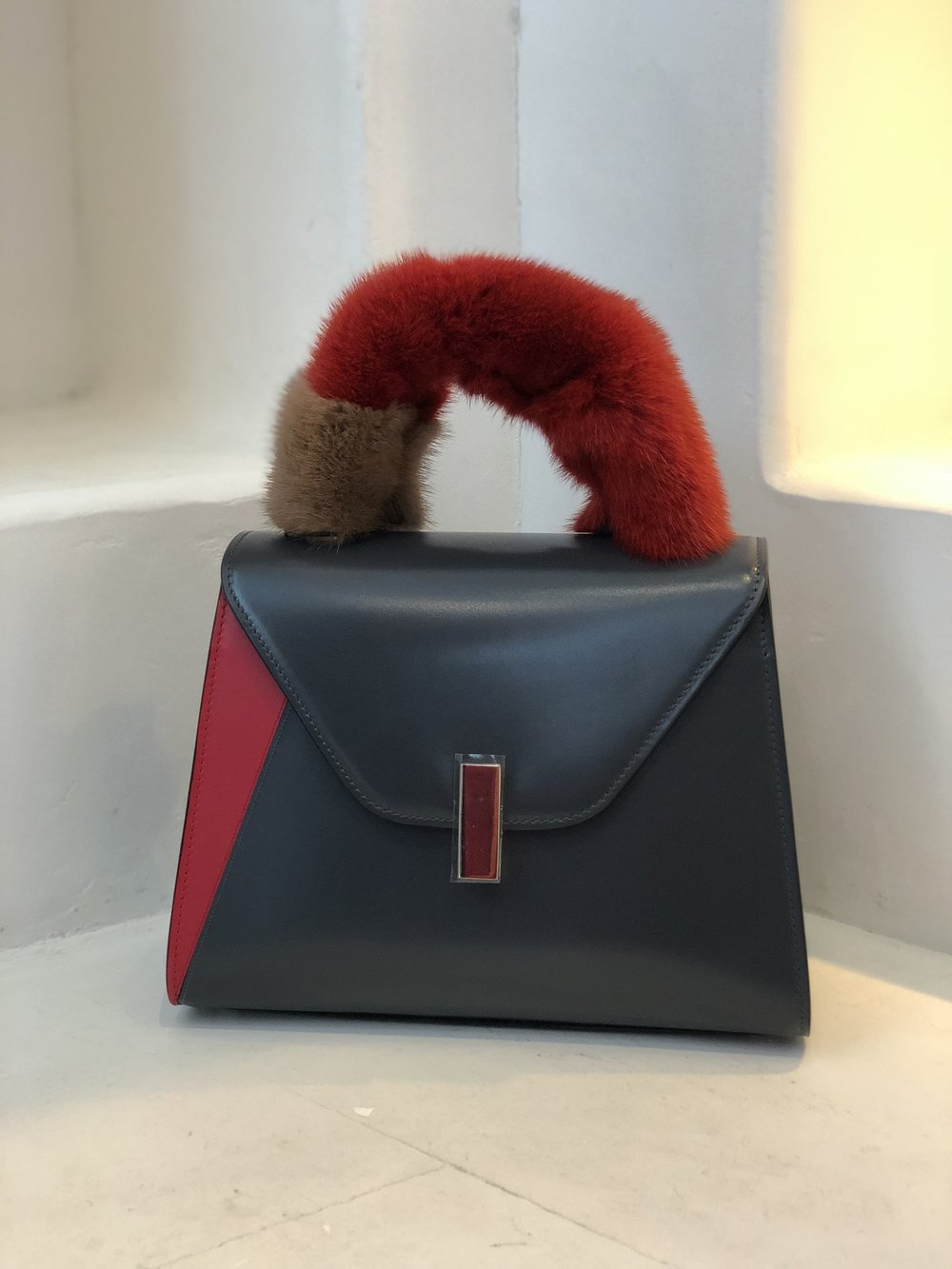 . . . followed by this gorgeous little Valextra bag (complete with detachable fuzzy handle)