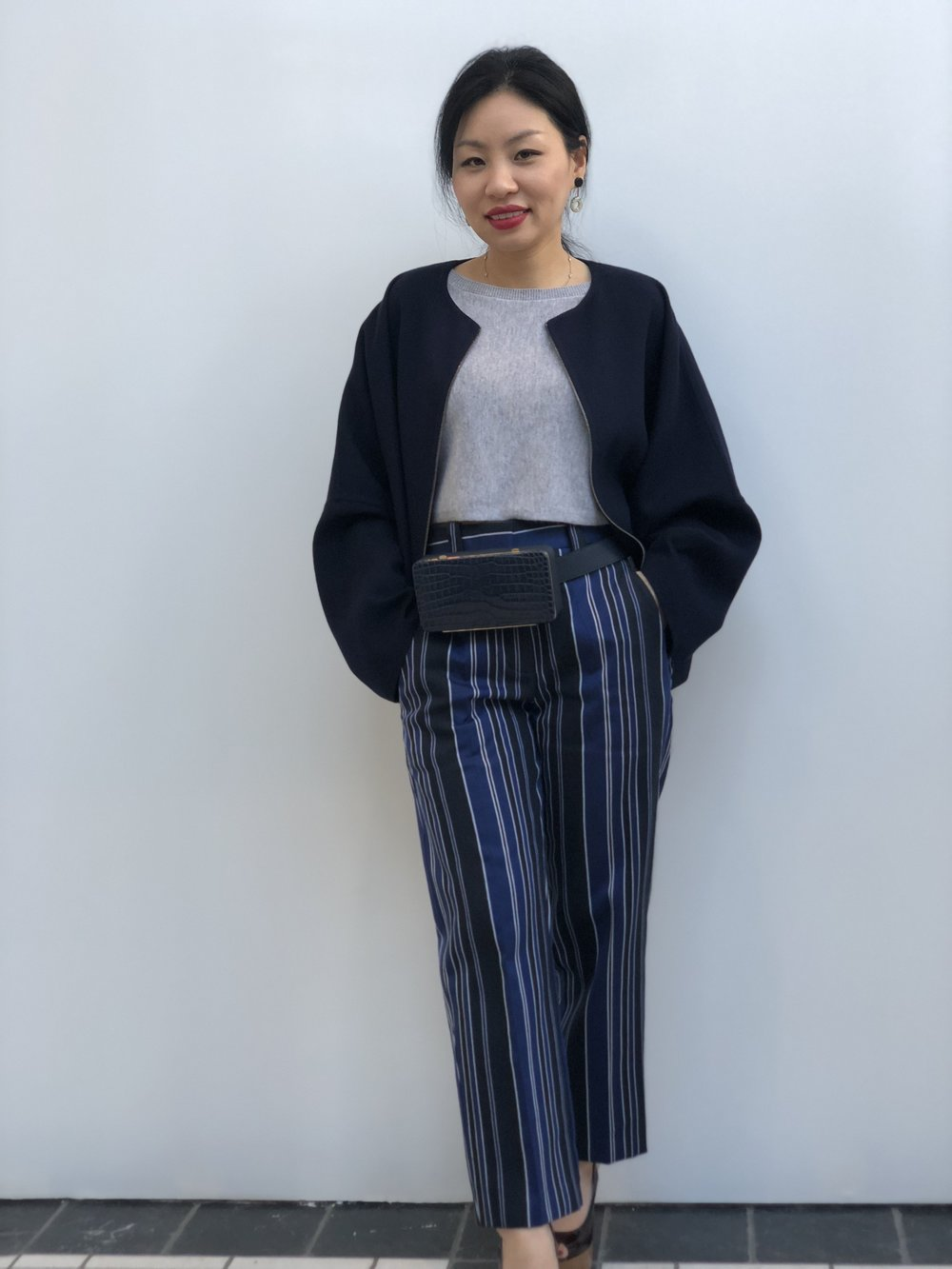 Yura wears a Fabiana Filippi jacket with Erika Cavallini pants . . .