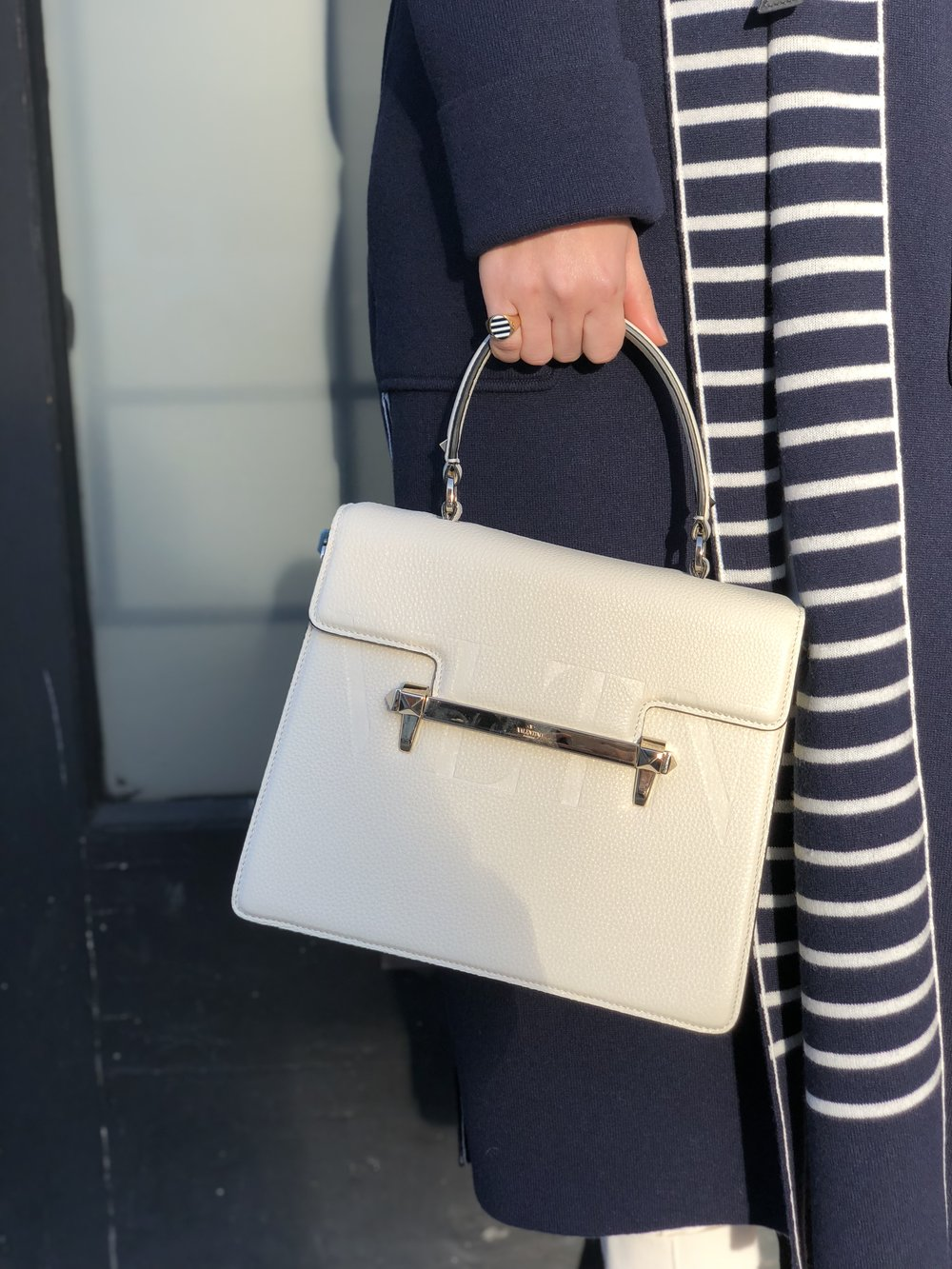 Plus coordinating ring by Jessica Biales and a classic Valentino handbag.