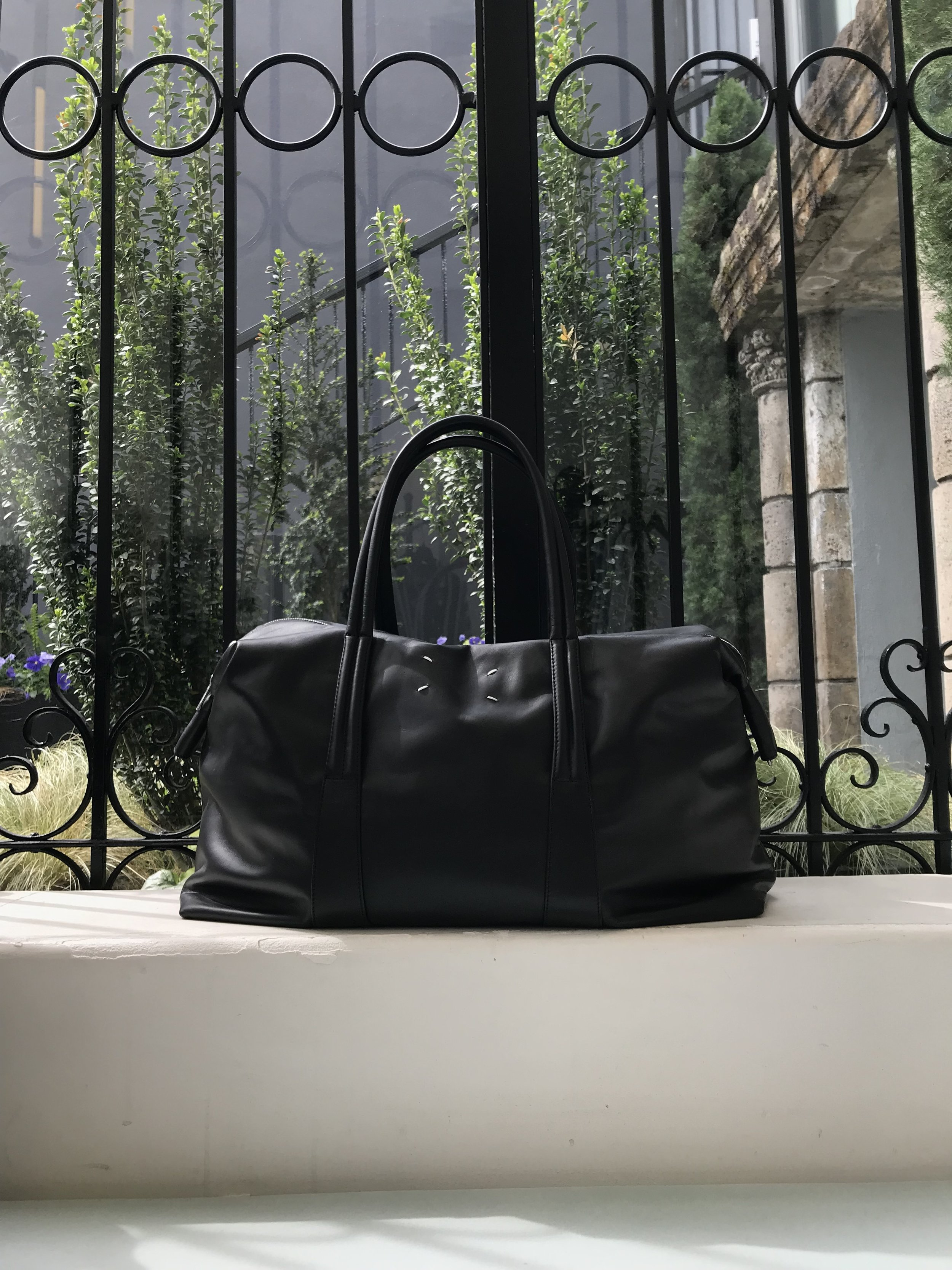 . . . but only if she can bring this Maison Margiela duffle bag.