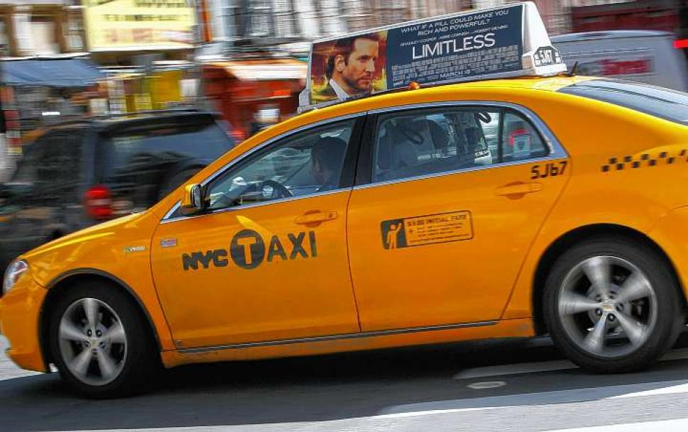 Rooftop Advertisement on NYC Taxi