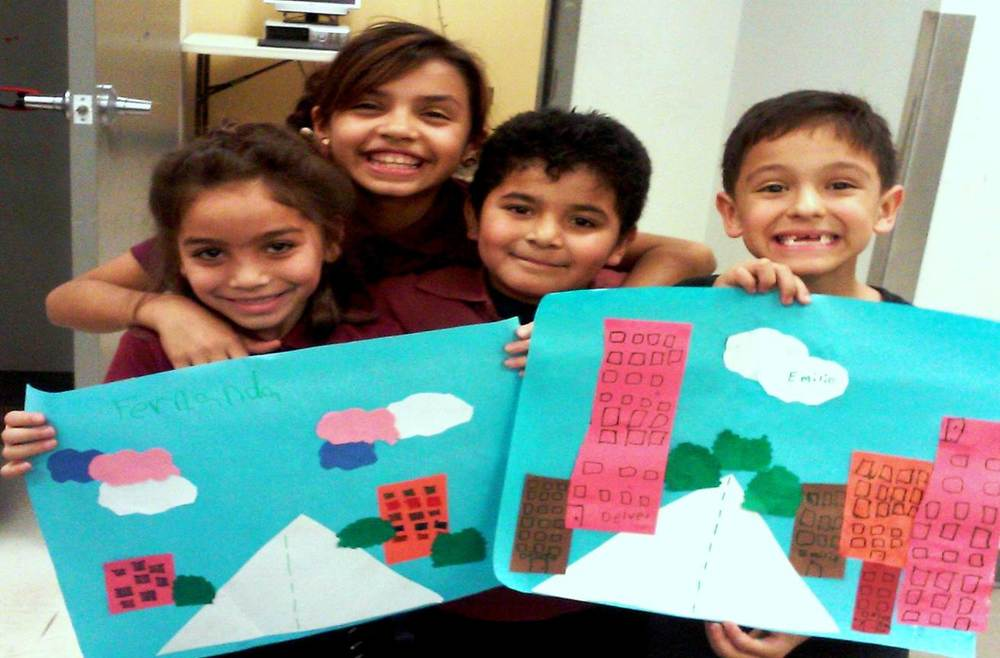 After-School participants show off their art projects.
