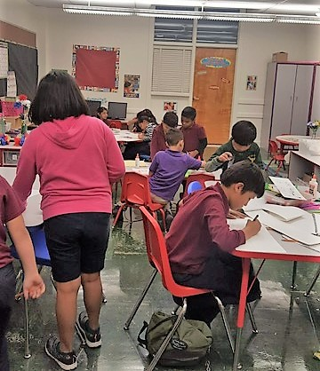 Children work on school assignments in Project Vida Zavala Center Child Care program.