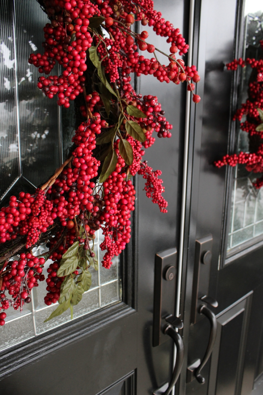 Red Berry Holiday Wreaths on Black Front Doors- Styling by Laura Design Co.