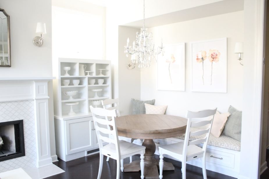 Built-in dining nook in white classic kitchen.