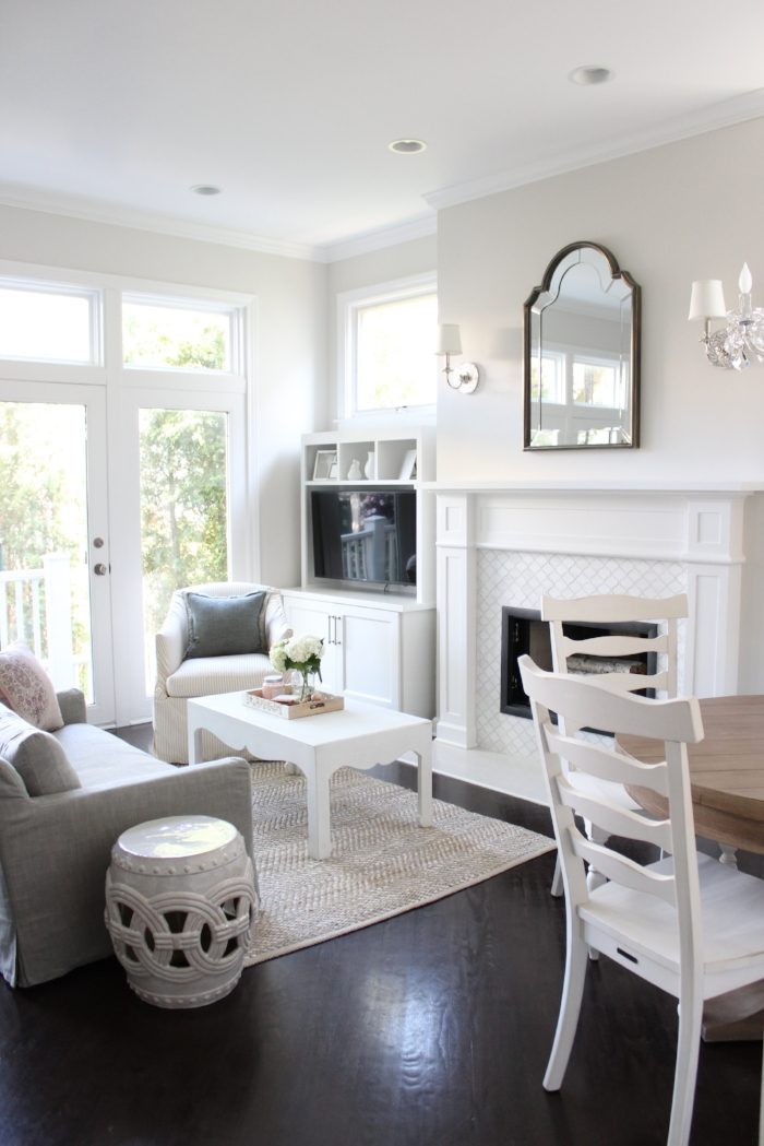 Classic white kitchen with lounge space and built-in dining nook- Laura Design Co., Chicago Interior Design
