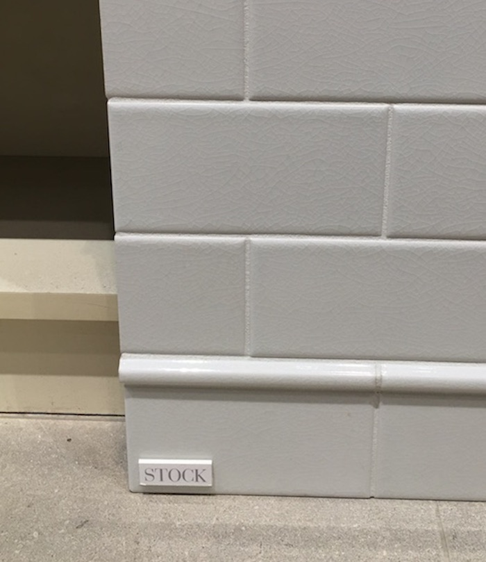 White subway tile with skirting trim- Laura Design Co.