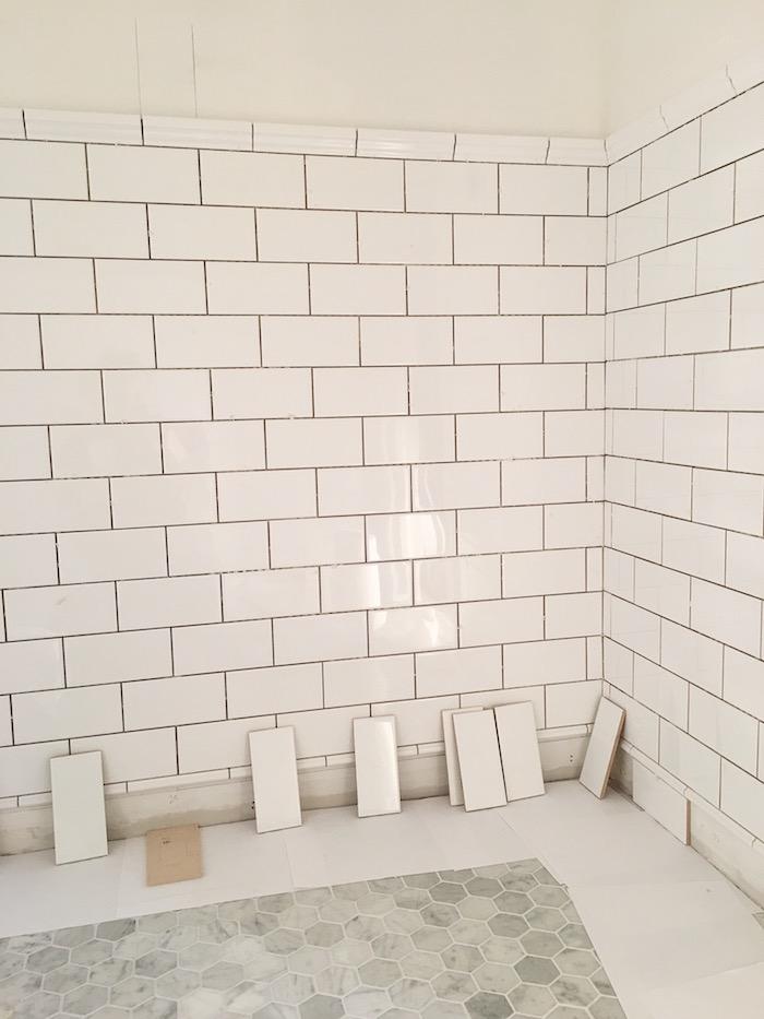 Powder room white subway tile wainscotting- Laura Design Co.