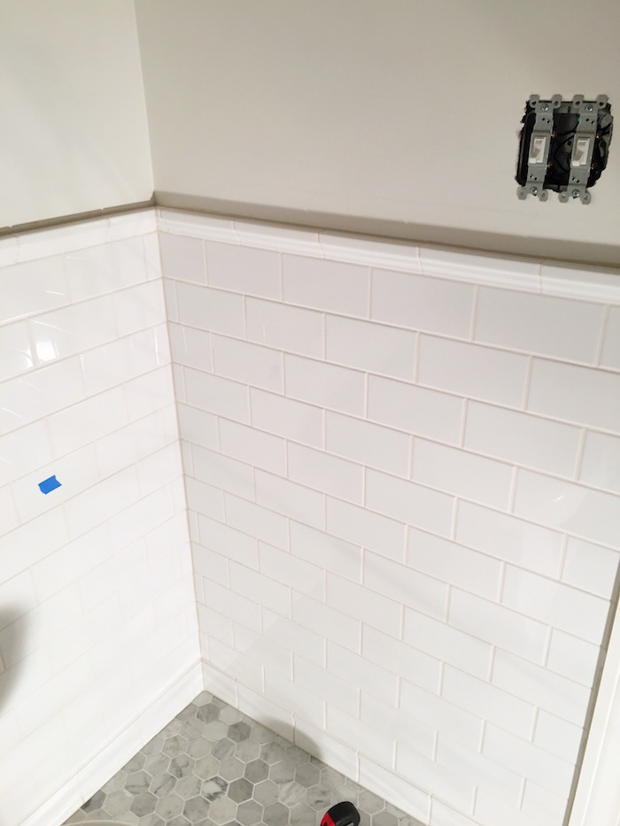 One Room Challenge- Powder Room New Build by Laura Design Co. - White Subway Tile with contrasting off-white grout