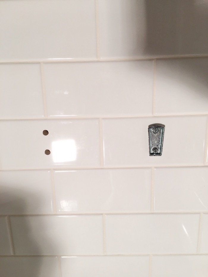 Installing a toilet paper holder on top of ceramic tile