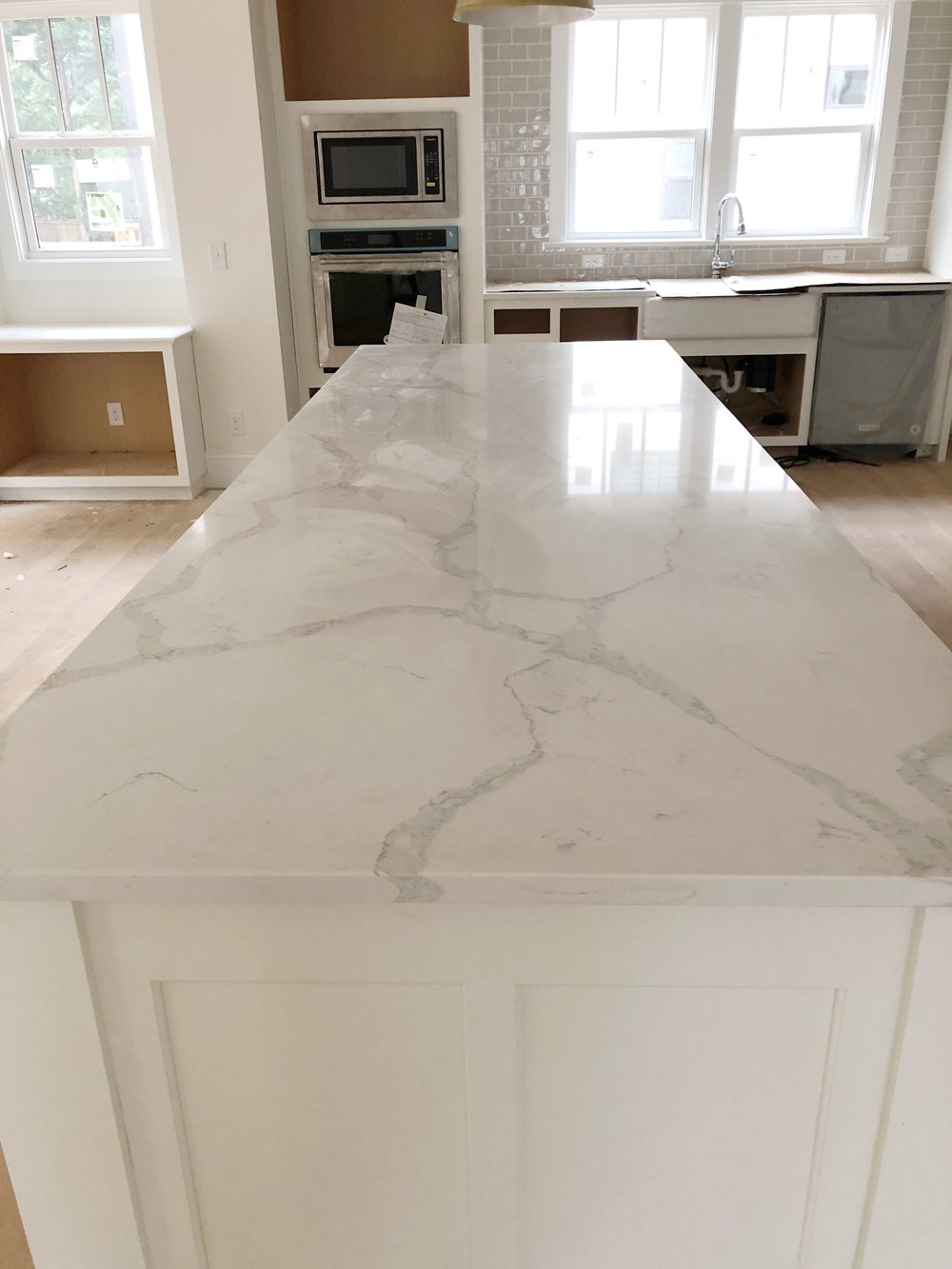 MSI Calacatta Verona Quartz Countertops - New construction Charlotte, NC, Timberline Homes, Interior Design by Laura Design Co.