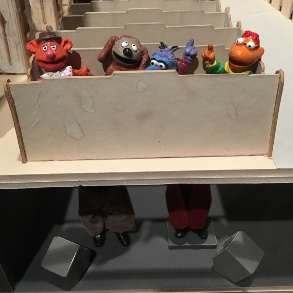 """A set design for """"The Muppets Take Manhattan"""" shows how performers are hidden from the cameras."""