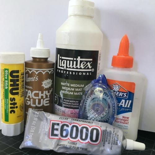 My glues on hand: UHU glue stick, Aleene's Tacky Glue, Liquitex Matte Medium Tombow tape runner, Elmer's Glue All and E6000