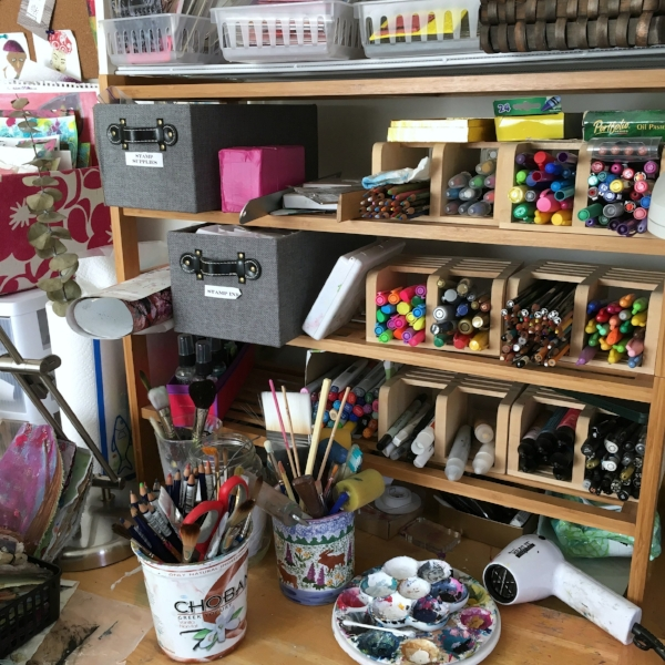 Art supplies everywhere in my art studio at home.